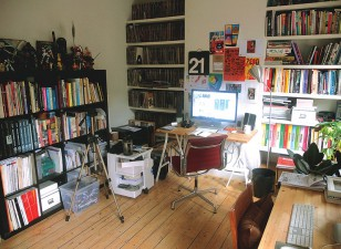 Tom Muller's office, with comic collection and comic work close by